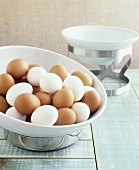 White and brown hard-boiled eggs in a bowl