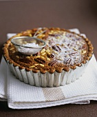 Pecan and pine nut tart with treacle
