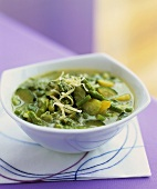 Spring vegetable soup with cheese and pesto