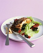 Spicy summer salad with grilled salmon