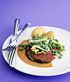 Sirloin steak with mustard, peas and potatoes
