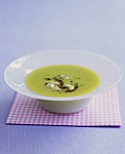 A dish of broad bean soup with tapenade