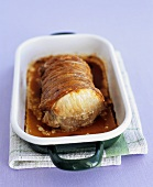 Rolled roast pork in a roasting dish