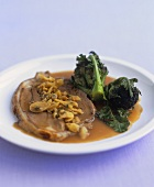 Shoulder of lamb with almond stuffing and cider sauce