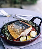 Sea bass on Mediterranean vegetables with olive oil