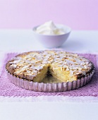 Apple and almond tart with whipped cream