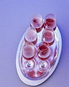Several glasses of rosé sparkling wine
