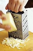Grating cheese with a cheese grater