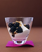 Fresh blackberries with sour cream