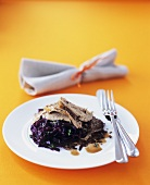 Slow-cooked duck with five-spice powder on red cabbage