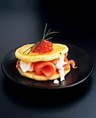 Potato pancakes with smoked salmon, horseradish and caviar