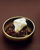 Christmas pudding in gold bowl