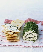 Fresh goat's cheese roll with chives, crackers