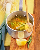 Leek and carrot soup with ginger and garlic in pan