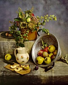 Autumnal still life with apples, quinces and plums