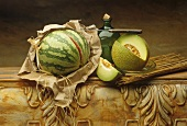 Still life with watermelon and netted melon with a piece removed