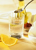 Fitness drink for detoxification: water with oil and lemon
