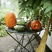 Carved pumpkins and besom broom