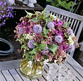 Vase of globe thistles and other flowers