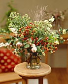 Arrangement of late summer flowers with wild berries