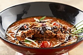 Asian hot and sour soup with shrimps and chocolate sauce