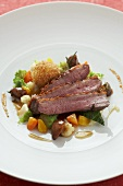 Barbary duck breast with spiced skin, vegetables & dumpling