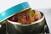 Melon caviar (molecular cuisine) in a tin