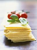 Lasagne sheets, basil, tomatoes