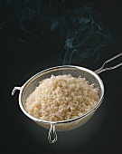Steaming rice in a sieve