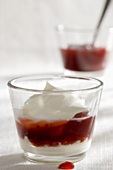 Strawberry compote with yoghurt cream & whipped cream in glass