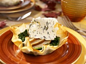Spinach, pear and blue cheese in filo pastry basket