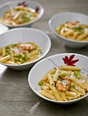 Pasta with shrimps and fresh green soya beans (edamame)