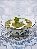 Coriander soup with fish and quail's egg