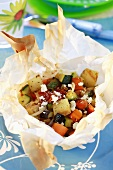 Briam (oven-baked vegetables with feta) in greaseproof paper