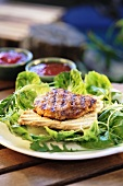 Grilled hamburger steak on bread and bed of lettuce