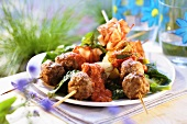 Meatball kebabs with spicy sauce