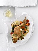 Rabbit leg cooked in white wine with vegetables