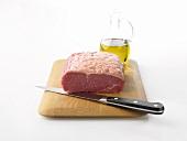 Raw rump steak on wooden board
