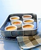 Crème caramels in ramekins in a bain-marie