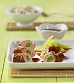 Pork and cucumber rolls with teriyaki sauce