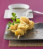 Deep-fried fish and mango skewers