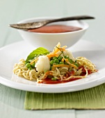 Fried Chinese egg noodles with vegetables and tomato sauce