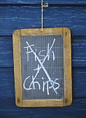 The words 'Fish & Chips' crossed out on a blackboard