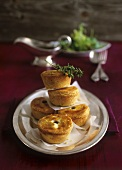 Small meat pies with sauce-boat of Cumberland sauce