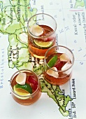 Three glasses of rose punch on a map