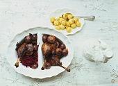 Goose legs with plum wine, red cabbage and small dumplings