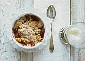 Apple and red wine crumble and a glass of vanilla cream