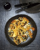 Baked pasta rolls with chard filling