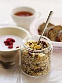 Muesli, yoghurt and breakfast ingredients behind