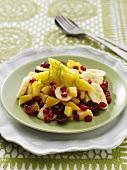 Mango, banana, orange & grape salad with pomegranate seeds